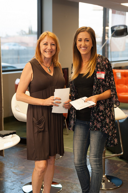 Dale Evins, winner of the Opal Bed, excitedly accepts her certificate from LA Furniture's Nicole Brahney.