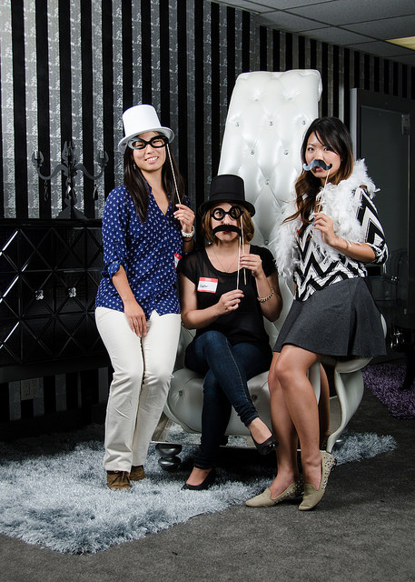 Three Students having fun in the photo booth.